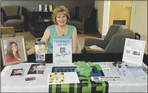"AUTHOR AND ADVOCATE- Marcy Robitaille, author of ""Wish You a Goode Journey - Living with Eyes and Heart Wide Open,"" is shown at on information table for Donate Life New England at Athol Hospital this past Friday. Robitaille's writing and volunteer work with Donate Life and New England Organ Bank is done in memory of her 17-year-old daughter Mackenzie Goode, a posthumous organ donor. She will speak at the Athol Public Library on April 13in conjunction with National Donate Life Month."
