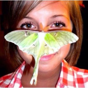 """Pictured is Leah with the luna moth that was keeping everyone entertained at the graduation party.... """" life is Goode"""""""